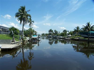 Vacant Cape Coral Waterfront Lot - Tear Down House
